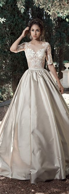 Dress designed by Milva View Post View Gallery