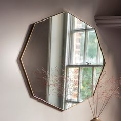 Octagon-shaped wall mirror with metal frame in silver, black champagne finish. Hang up the Courtney mirror in the living room now, for a different tomorrow.