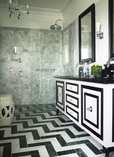 black and white cabinets mixed with chevron tile floor