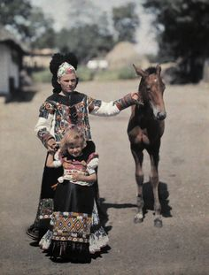 Europe | Portrait of mother and daughter wearing traditional clothes and headdress, Mezokovesd, Borsod, Hungary #autochrome