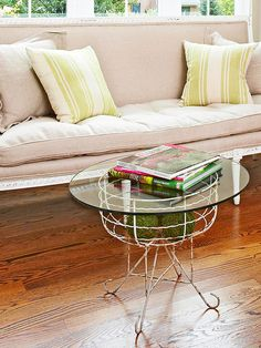 Place a glass top on a vintage plant stand to create a chic accent table. More flea market makeovers: http://www.bhg.com/decorating/decorating-style/flea-market/flea-market-makeovers/?socsrc=bhgpin062413gardentable=7