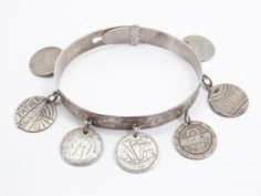 This is a wonderful antique bracelet set with seven engraved love tokens. The bracelet is finely crafted in American/Canadian coin silver and features an adjustable clasp.