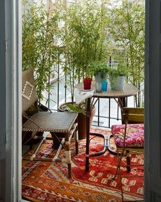 Eclectic Bohemian Balcony with Patterned Carpet Rattan Chair Round Table Potted…