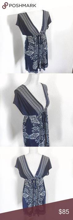 Neslay Paris Blue and White Dress Small / Medium This gorgeous French import is from Neslay Paris. The classic navy and white print is offset by a sexy, very deep vee neckline in both the front and the back. The fabric is slinky and light. Tie accent at waist that can be tied in a bow in front or back. 96% Viscose, 4% Spandex. Size Small / Medium. Neslay Paris Dresses Midi