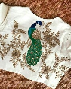 Image may contain: 1 person Choli Blouse Design, Wedding Saree Blouse Designs, Fancy Blouse Designs, Saree Wedding, Hand Work Design, Hand Work Blouse Design, Peacock Embroidery Designs, Hand Work Embroidery, Flower Embroidery