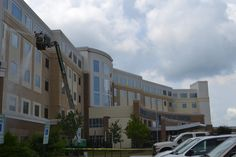 Washing a local hospital using an 80 ft. aerial lift.