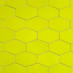 """Clayhaus Stretch Hex Tile - Chartreuse - Our ceramic stretched hex tile in color """"Chartreuse"""" is a bright green.  Sold  by the square foot. There are 11 tiles per square foot of material and they are shipped loose for easy installation. This tile is well suited as kitchen backsplash tile, bathroom tile or as any indoor wall tile. All Clayhaus for modwalls subway tiles are handcrafted in the USA. Our artisans take care to ensure the highest quality of workmanship goes into every step, from…"""
