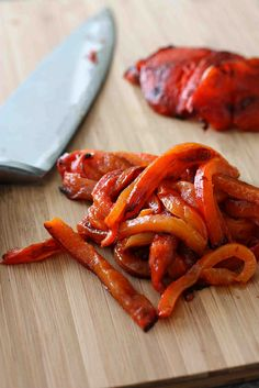 She's right... I'll never buy Roasted Red Peppers again. The skins took a long time to burn and blacken, but they are easier to remove when in that state. RoastedPeppers by CookinCanuck, via Flickr