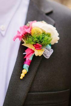 bright boutonniere #groom #boutonniere #weddingchicks http://www.weddingchicks.com/2014/02/21/surprise-engagement-session/