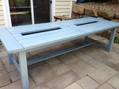 Build a DIY patio table with a drink cooler and matching benches. The built-in ice boxes are covered when not in use, making a perfect picnic table for outdoor dining. Bar Table Diy, Outdoor Bar Table, Pub Table Sets, Outdoor Decor, Bar Tables, Patio Tables, Outdoor Spaces, Outdoor Living, Bar Building Plans