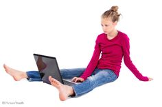 Young teen middle school girl using her laptop computer for social media.  #child  PictureYouth.com