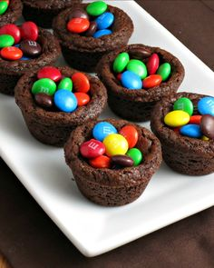 Chewy chocolate chocolate chip cookies baked into a cookie cup topped with M&Ms. M&M Chocolate Cookie Cups are always very popular!