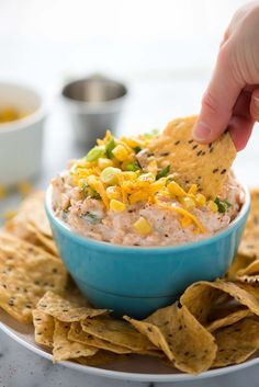 Greek Yogurt Spicy Corn Dip is a simple and quick, make-ahead appetizer! Creamy greek yogurt mixed with crisp corn, cheddar cheese and a bit of spice.