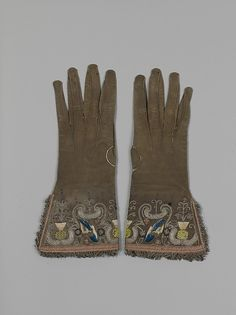 Pair of gloves, British, ca. 1620. Leather, silk, and metal thread. source: metmuseum.org