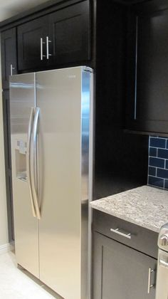 Counter depth refrigerator fits nicely into the cabinet to provide a clean look.