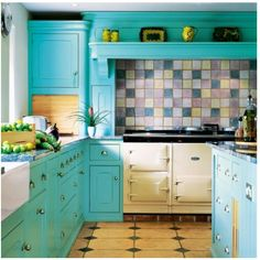 Turquoise cabinets in a turquoise kitchen