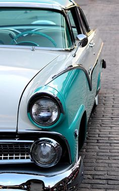 1955 Ford Fairlane. I'm so into classic cars. Especially ones that are this color with the chrome. Beautiful:)