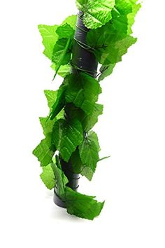 cool  Artificial leaf vine, with leaves hanging down to offer extra cover and a great naturalistic look Material : Plastic and Fabric; Main Color : Green; Each strand is approx 7.5Ft;Each order contains 12 strand.   https://www.silkyflowerstore.com/product/bird-fiy-7-5-ft-20-pcs-home-decorative-artificial-grape-vine-plant-leaves-garland-home-garden-wall-decoration/