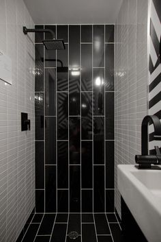 black and white bathroom/shower- I like the subway treatment from the floor & up the wall
