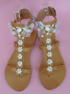 Handmade leather sandals with French ribbons, glass beads, glass pearls, metallic daisies with swarovski rhinestone, swarovski fancy stones and ivory with swarovski flat back