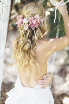 Laura! You could be Rapunzel!! Peach colored roses interwoven into a long, blonde feathered fishtail braid. Formal decorative hairstyle.
