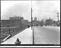 "1928 ""THEN"" view looking north on Bay St., near Harbour St. I suspect that the two buildings under construction (Royal York Hotel and Toronto Star Building) will be well-hidden behind today's skyscrapers. However, the Old City Hall clock tower may still be visible."