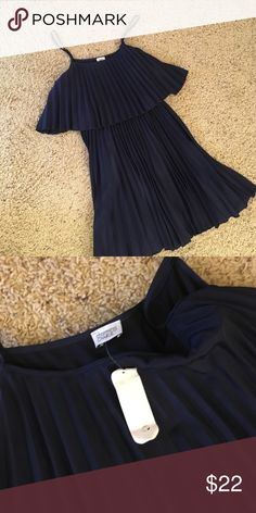"""🎉HP🎉 NWT Charming Charlie navy blue mini dress. Super cute navy blue Charming Charlie dress.  Pleated, two tier design.  Adjustable straps.  Has never been worn, but the store tag got damaged so I can't return it.  :(  27"""" long from the top of the bodice to the bottom of the hem (not including the straps which add another 6-7"""" in length).  🎉HP Everyday Essentials 4/3🎉 Charming Charlie Dresses Mini"""