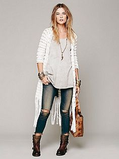 10/25/13 - This look screams Nashville style and we love it! A fringe knit sweater paired with worn jeans and adorable booties. It's a hit!