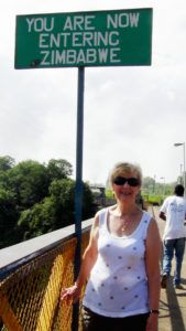 Kathy Slamp standing on the Victoria Falls bridge that divides Zambia and Zimbabwe.