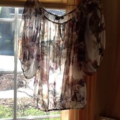 Ana floral sheer blouse. Breezy sheer floral top from A.n.a.  Raglan short sleeves. Elastic at waist, neck and waist. So pretty. Like new condition.  Polyester. a.n.a Tops Blouses