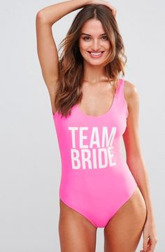 Team Bride! This gorgeous pink hen party suit suit is perfect for a hen do abroad or for a destination wedding! Available here. #hen #party #swimsuit #hens #weekend #sunny #abroad #team #bride #ideas #themes