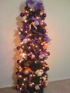 Clemson Christmas Tree! This is my goal to have enough ornaments to fill a 6ft tree.  Maybe one day!!! Bebe'!!! Cute Christmas in Orange and Purple!!!