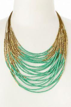 Like the 2 tone effect with gold, but with random lengths of the gold interspersed with the colored beads--Gold  Mint Beaded Bib Necklace