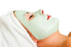 Relaxing with a green apple facial mask at a beauty spa.