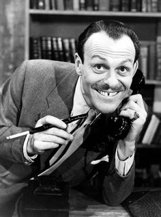 British funny man Terry-Thomas on the phone