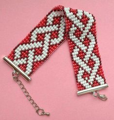 Stylish, made of Czech beads in shades of pearl-white and coral-red with an extension chain allowing the bracelet to fit any wrist. The colorful pattern give Loom Bracelet Patterns, Bead Loom Bracelets, Bead Loom Patterns, Beaded Jewelry Patterns, Beading Patterns, Bead Loom Designs, Motifs Perler, Bead Crochet, Loom Beading