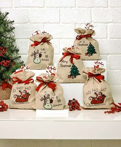 The Set of 6 Holiday Treat Bags is a fun way to give out wrapped candies or small gifts. They're designed to hold a bounty of treats.Send guests off with a holiday party favor, or give little gifts with this cheerful Snowman Treat Bags. Christmas Treat Bags, Christmas Wrapping, Diy Christmas Gifts, Simple Christmas, Christmas Projects, Handmade Christmas, Christmas Holidays, Christmas Crafts, Christmas Decorations