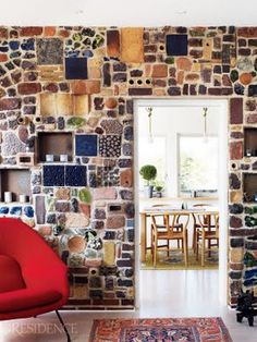 I like this idea of mix and match tiles but I would prefer this on a small accent wall