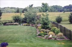Privacy builder ideas for the corners of my fence line - need on a smaller scale.