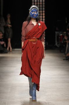 """The debut collection of Andreas Kronthaler for Vivienne Westwood is titled """"Sexercise"""", symbolising the journey Andreas went through creating this collection. Initially inspired by Vivienne's friend Sharon Lishman - a Buddhist nun, he fused the spirituality of all world religion to add a transcendent touch to his work. The collection silhouettes were also inspired by the costume collection book KOLNER PATRIZIER – UND BURGERKLEIDUNG DES 17. JAHRHUNDERTS demonstrating glorious noble garments…"""