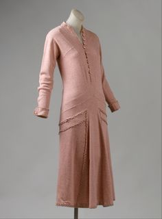 Gabrielle 'Coco' Chanel day dress of wool knit with braided self-fabric trim, c. 1924 #Chanel #1920s
