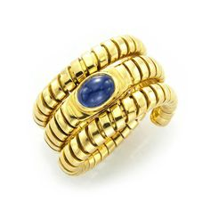 a gold and cabochon sapphire ring by bulgari circa
