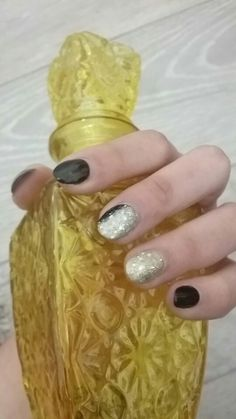 Gold and black oval nails