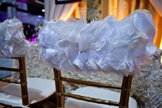 Golden Chiavari chairs were used with these ruffled chair caps from Wildflower Linen. Elegant, yet a touch of playfulness!