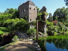 Garden+of+Ninfa+-+The+romantic+gardens+feature+medieval+ruins,+a+variety+of+trees,++meadows,+exotic+plants,+and+roses+that+grow+over+the+ruins.