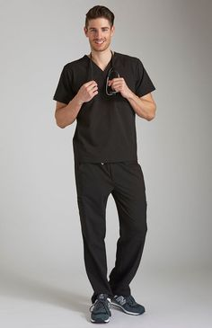 Double pocket men's performance scrub top with a modern, streamlined look. Four-way stretch and moisture-wicking fabric keep you comfortable.