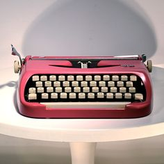 I think I learned to type on one of these...but it wasn't this awesome pink color!