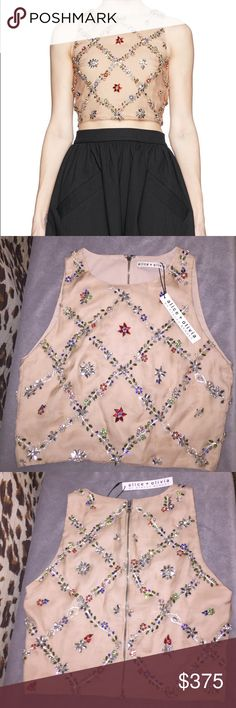 Alice + Olivia Kesten Beaded-Appliqué Crop Top This is an amazing Alice + Olivia Kesten beaded-appliqué crop top that has been seen worn by celebrities on tv and on the red carpet. A rare find that is sure to make you feel special when you wear it. The gorgeous red, green, blue, pink, and silver beading makes this piece more than a crop top, it becomes art. Alice + Olivia Tops Crop Tops