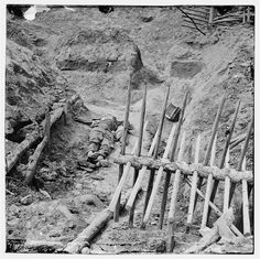 Civil War Photos - 826. Dead Confederate Soldier in a Trench - Petersburg, VA, April 1865