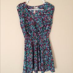 Floral sundress! Never worn! Really cute v-neck floral sundress! Great for the upcoming warm weather! Mimi Chica Dresses Mini